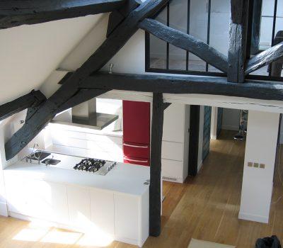 stignani-architecte.fr, aménagement d'un loft à Paris. Cuisine, rangements intégrés, poutres